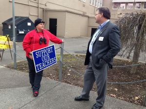 Medford Superintendent Phil Long talks with a striking teacher. From the Medford School District 549C Facebook Page